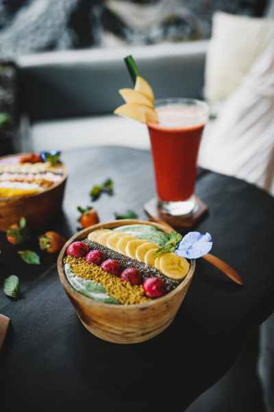 delicious dessert with fruits and juice on table